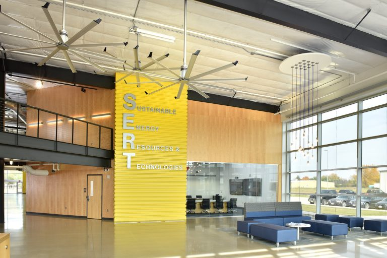 Interior entrance Commons with dramatic yellow signage