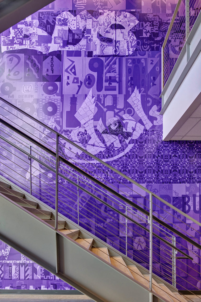 Purple mural wall graphic in stairwell