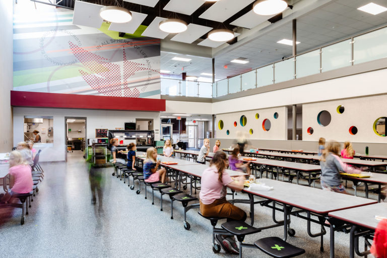 Cafeteria with wall graphic and ceiling clouds