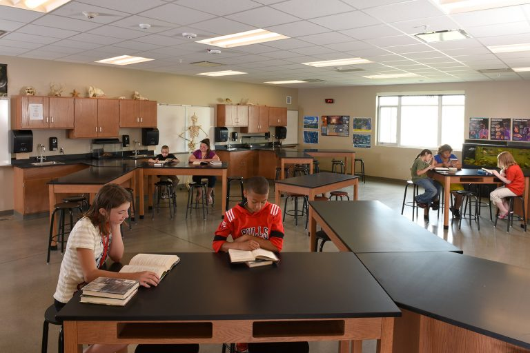 Science classroom with students reading