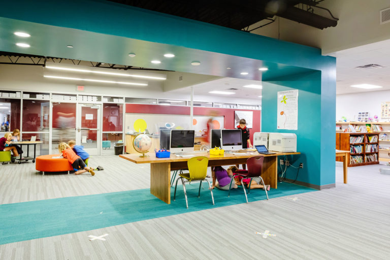 Media center featuring blue floor and ceiling elements