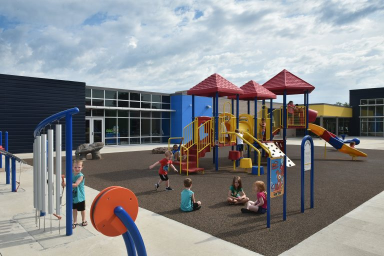Outdoor playground with new play structures