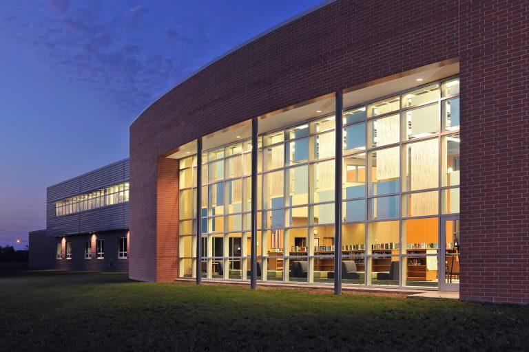 Exterior media center curtain wall at night