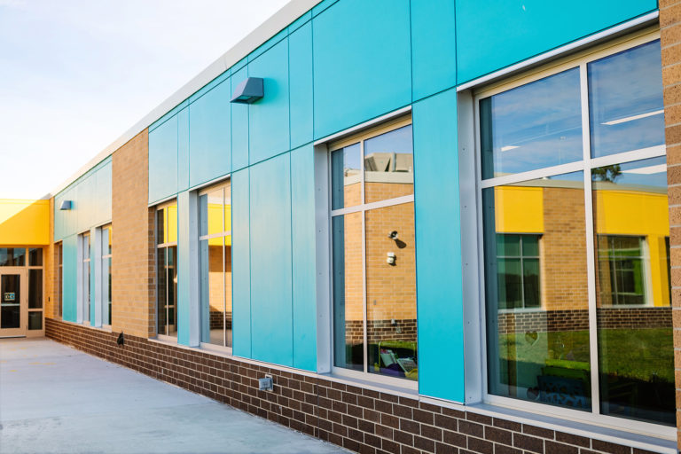 Exterior blue panels with reflections in glass