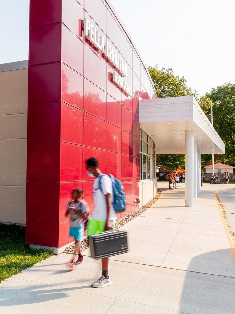 Exterior featuring curved red metal wall panels