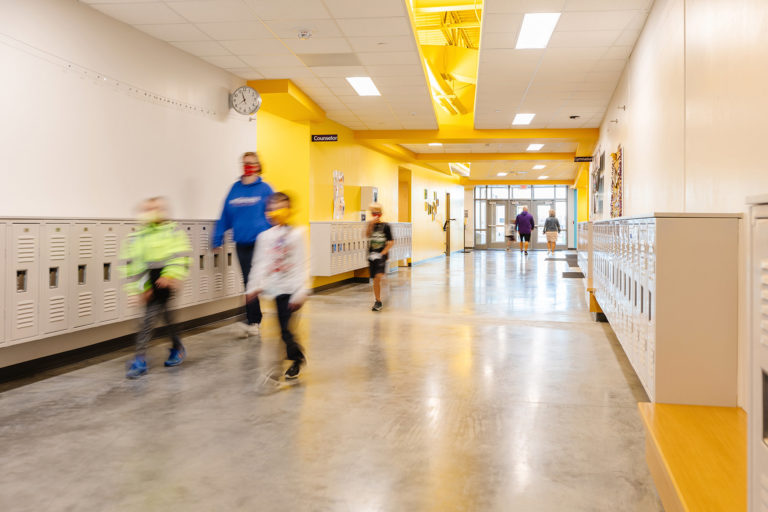 Corridor with yellow accents and students
