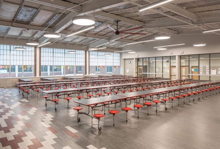 Cafeteria with tables and large windows