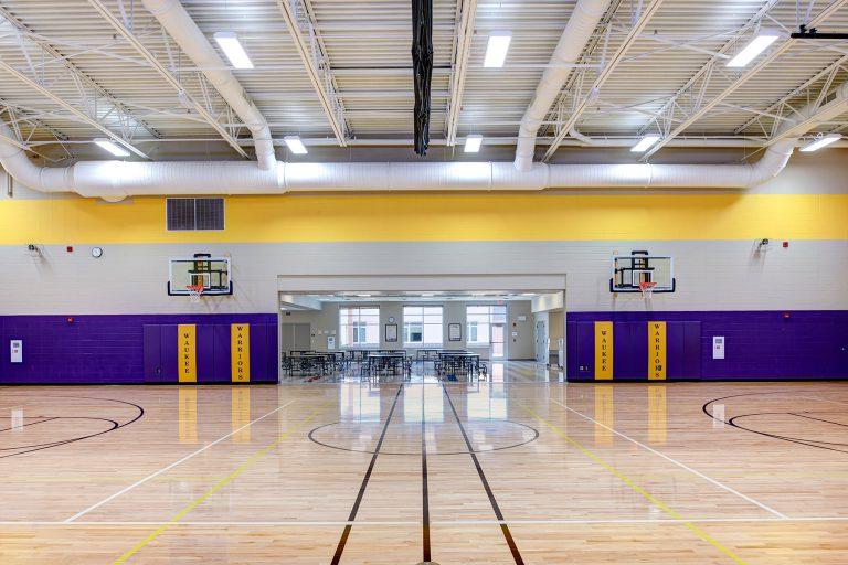 Gymnasium with entrance into cafeteria