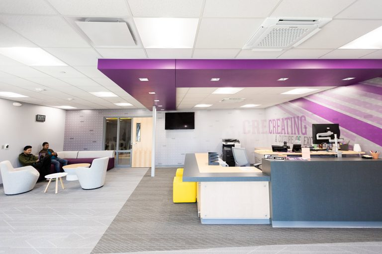 Reception desk with purple ceiling elements
