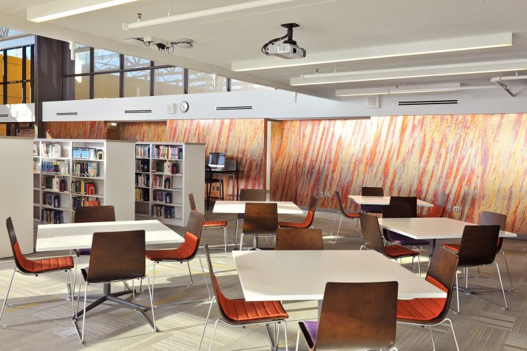 Media center interior with tables and chairs