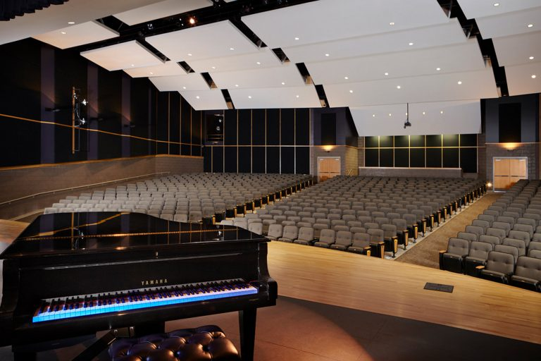 Auditorium highlighting piano and ceiling sound elements