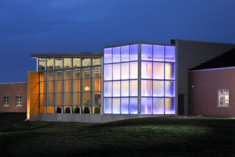 Night exterior with purple lit windows