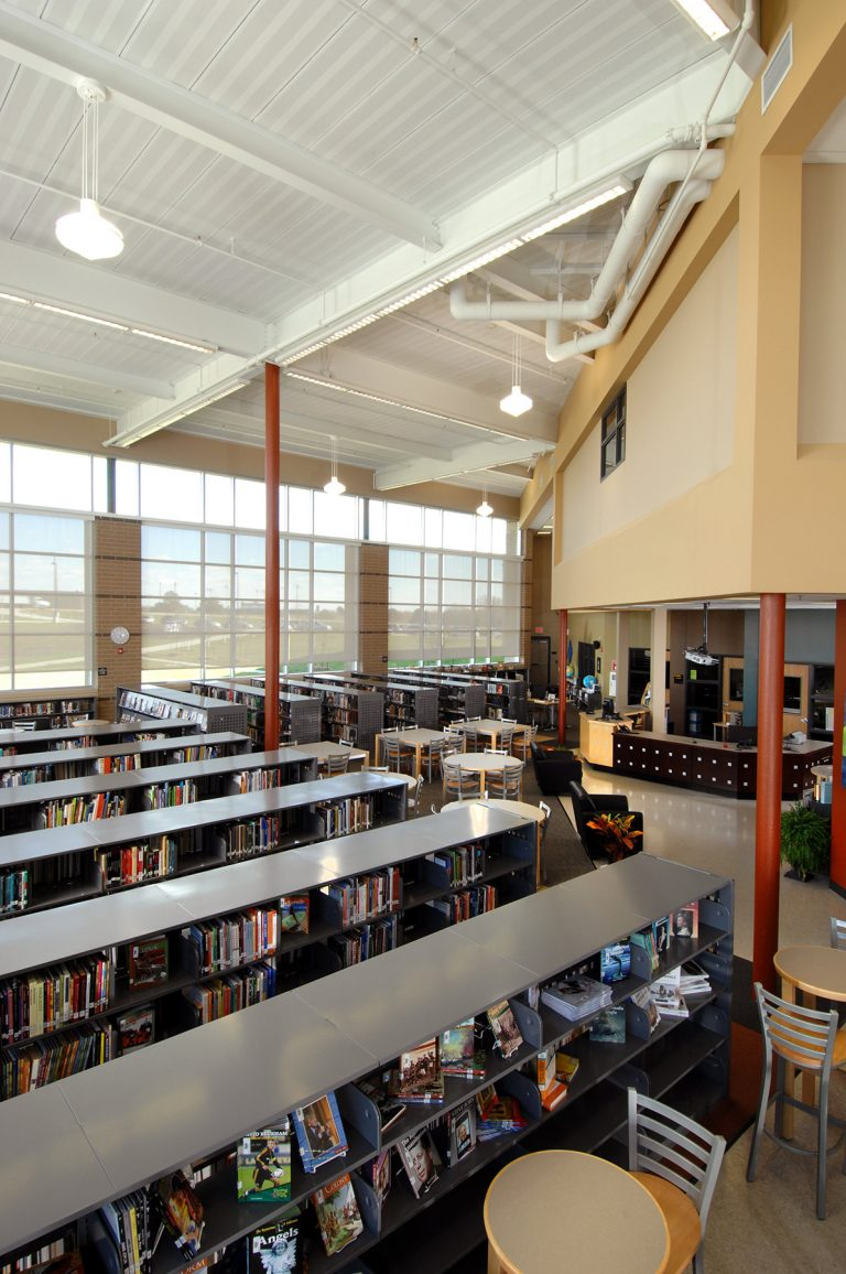 Library with stacks and large glass wall