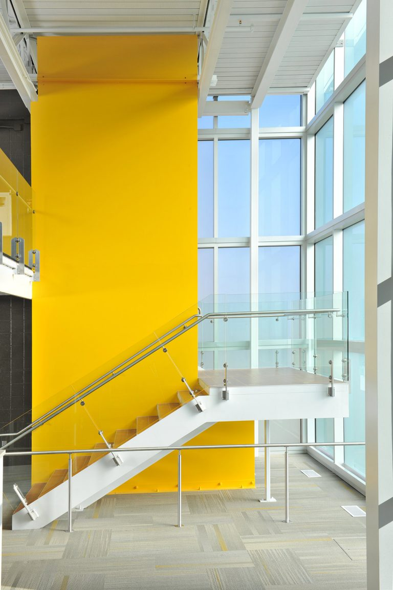 Interior stair with yellow highlight wall