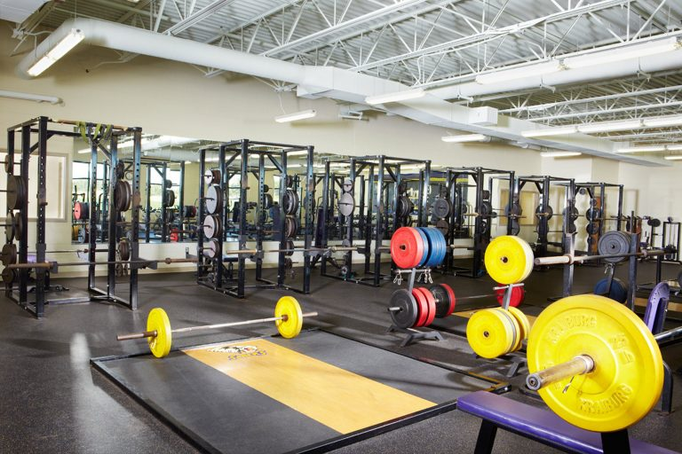 Weightroom with lifting platforms and racks