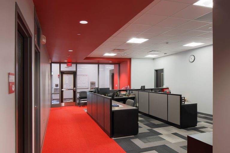 Office with red carpet and ceiling elements