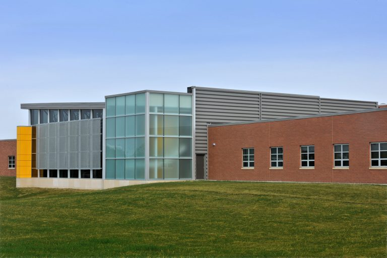 Exterior highlighting curtain wall and metal panels