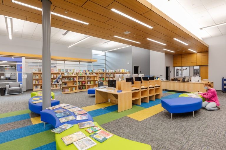 Media center with wood panel ceiling detail